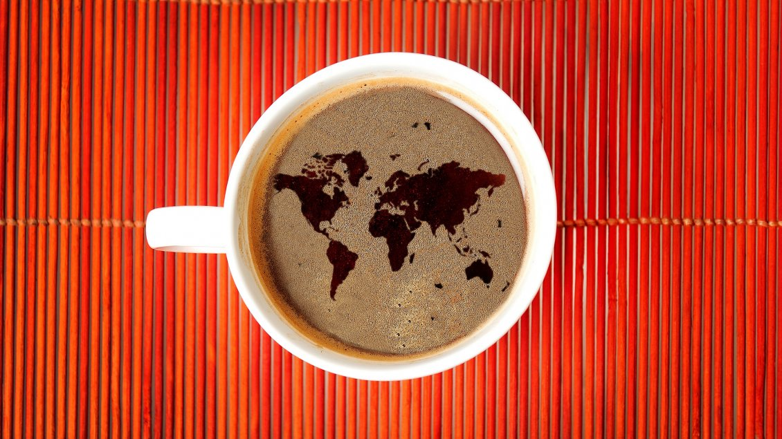 Download Wallpaper The earth map in a cup of coffe