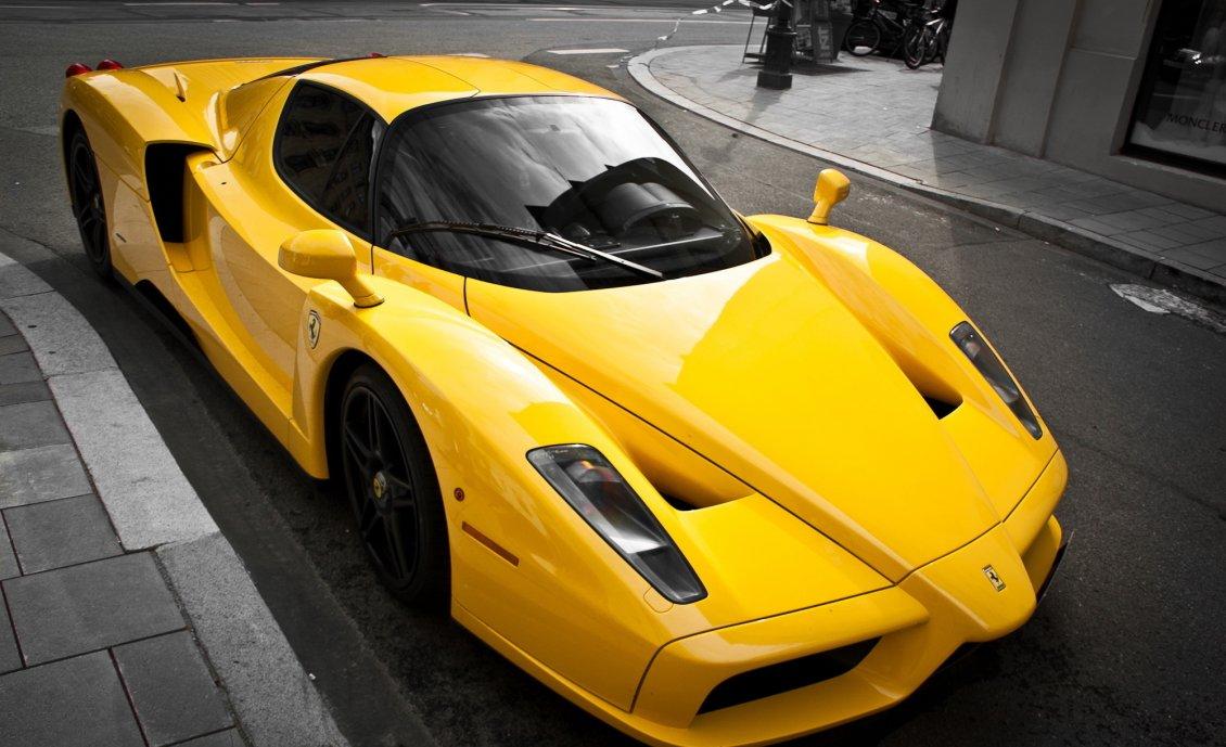 Yellow Ferrari Enzo on the street