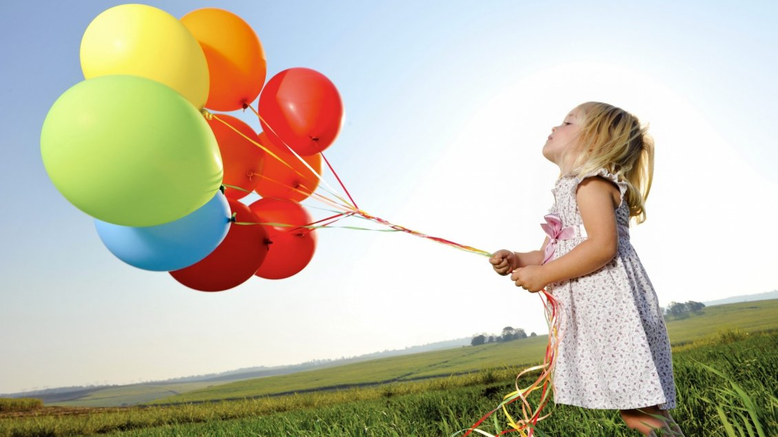 Download Wallpaper The girl with many colorful balloons in the grass