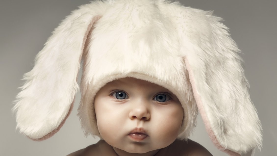 Download Wallpaper Cute child with white hat with bunny ears