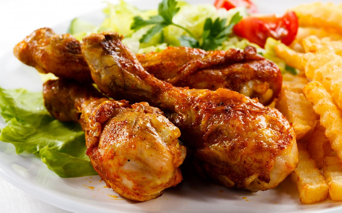 Download Wallpaper Chicken drumsticks and fries with salad and tomato