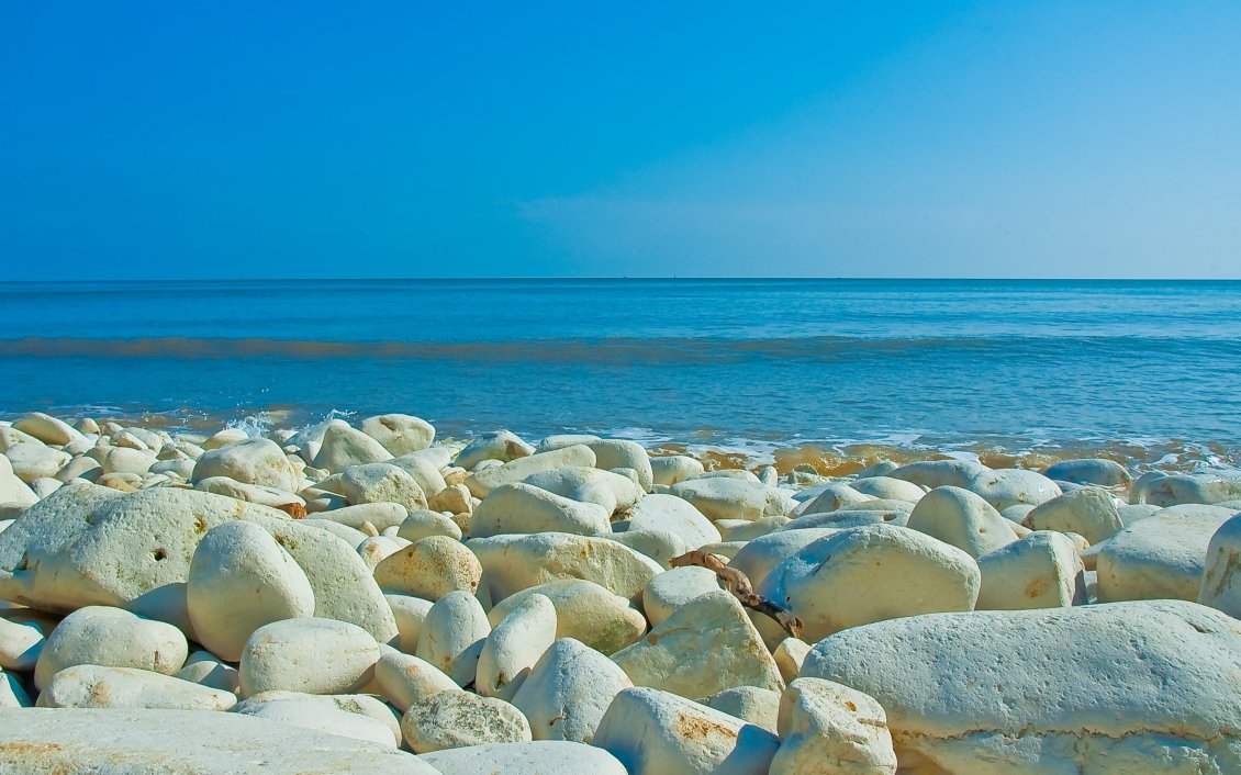Download Wallpaper White big stones on the shore of the sea
