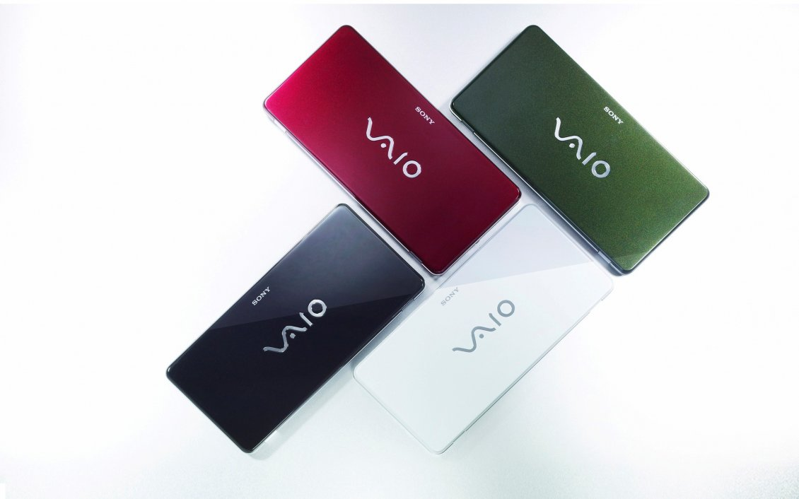 Download Wallpaper Four Sony Vaio laptops in different colors