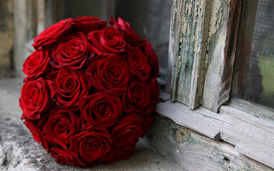 Wedding Bouquet Of Red Roses On Windowsill