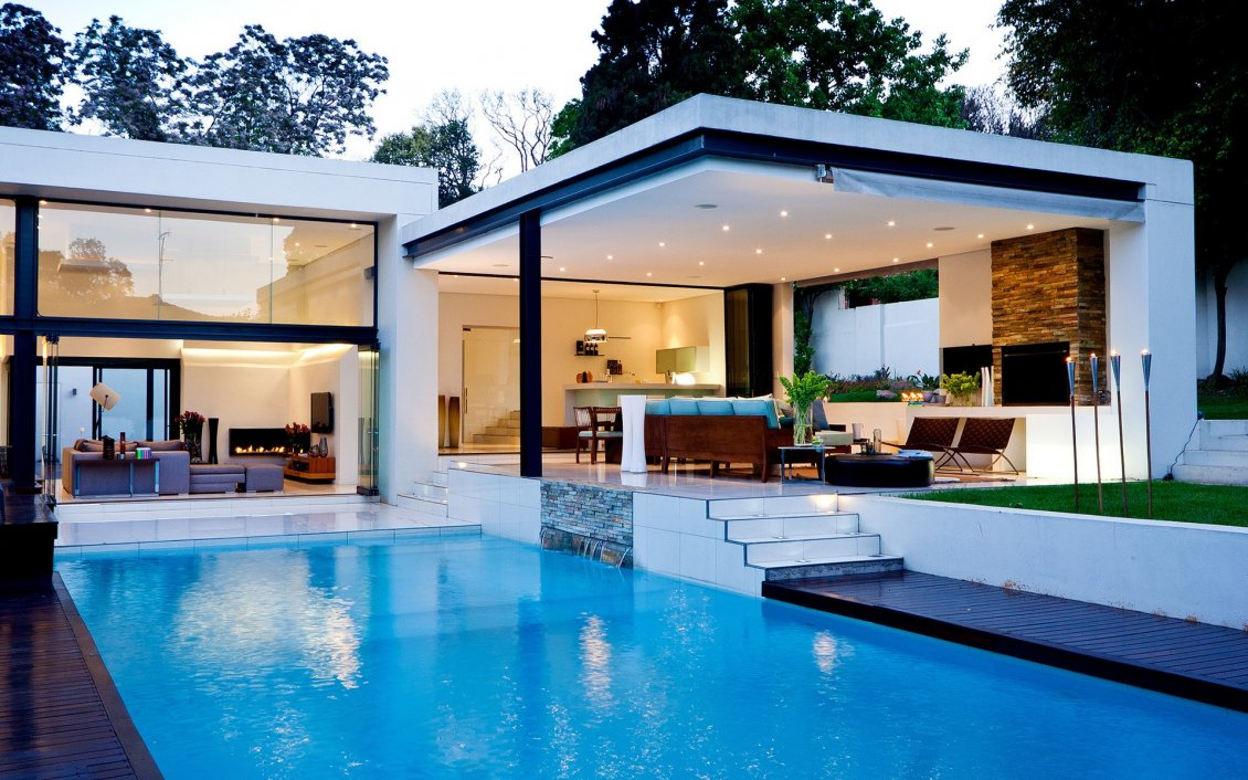 Beautiful white house with swimming pool for Beautiful house designs with swimming pool