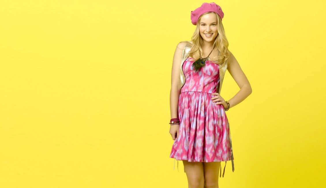 Download Wallpaper Bridgit Mendler in pink dress on the yellow background