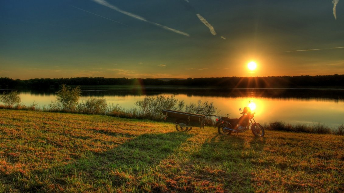 Download Wallpaper A motorcycle with trailer near the river in the sunset