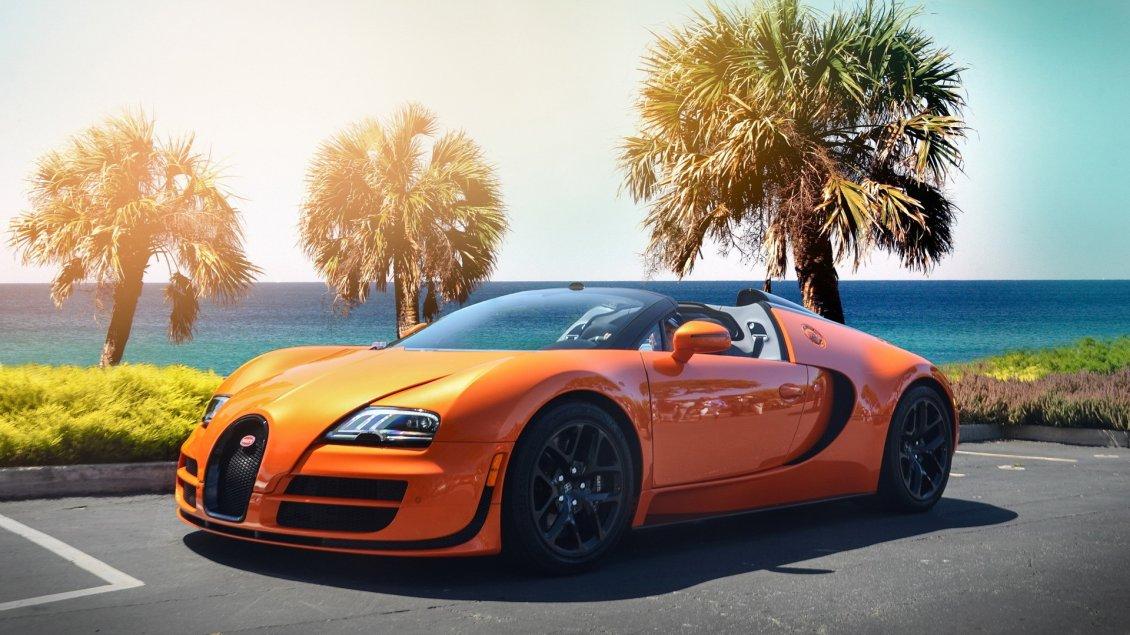 gorgeous orange bugatti veyron w16 on the shore of sea. Black Bedroom Furniture Sets. Home Design Ideas