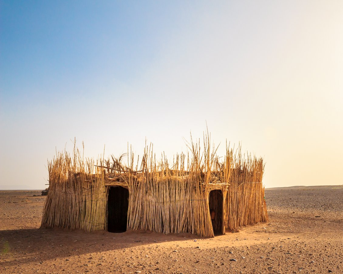 A House Made Of Straw In The Middle Of Desert