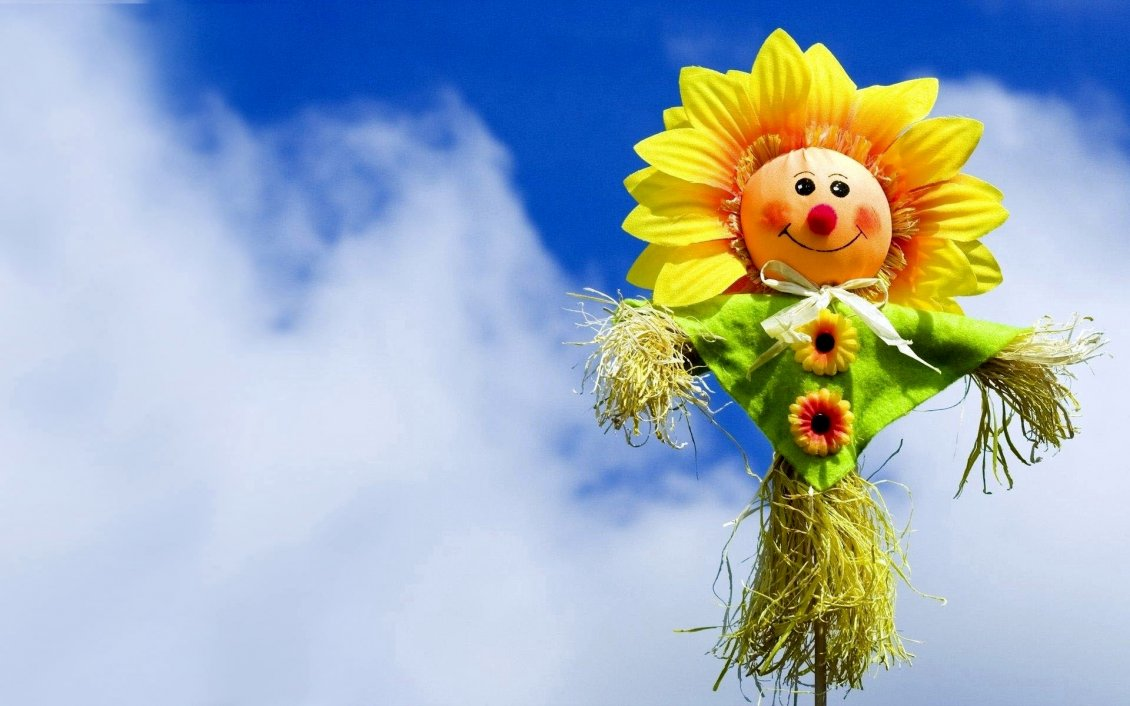 Download Wallpaper Scarecrow made of flower and straw in the sky