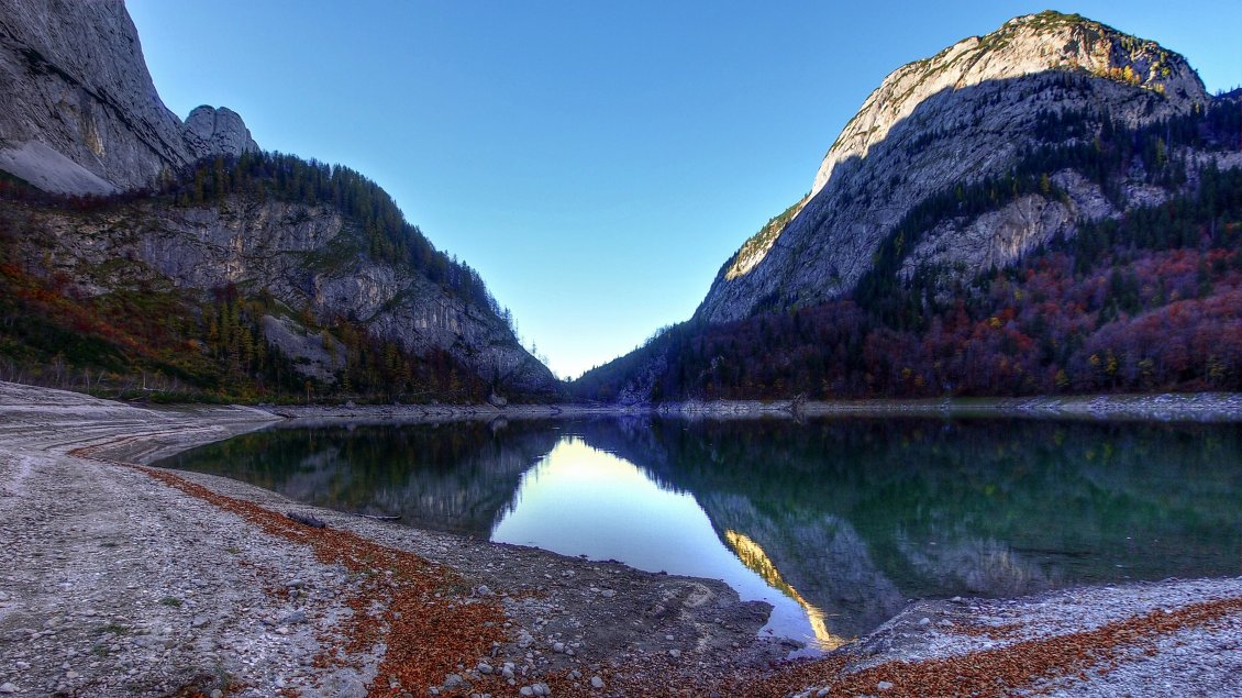 A Lake Surrounded By Mountains Hd Wallpaper