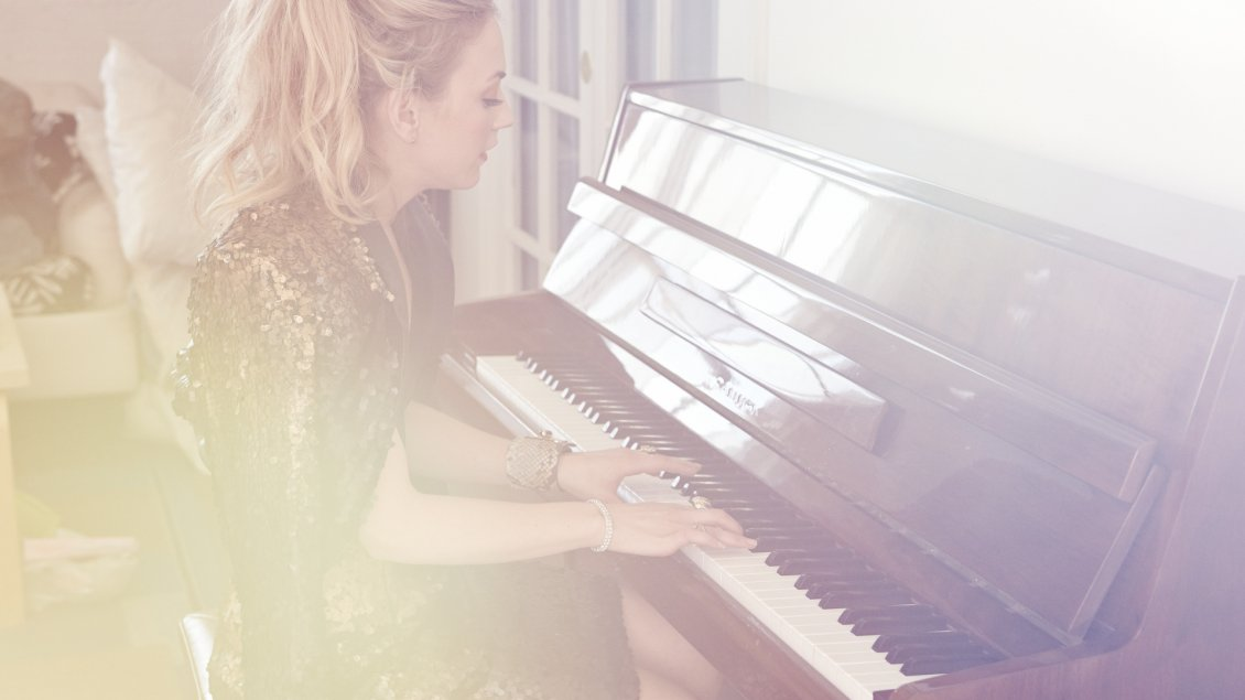Download Wallpaper Emily Kinney, an American actress, playing the piano