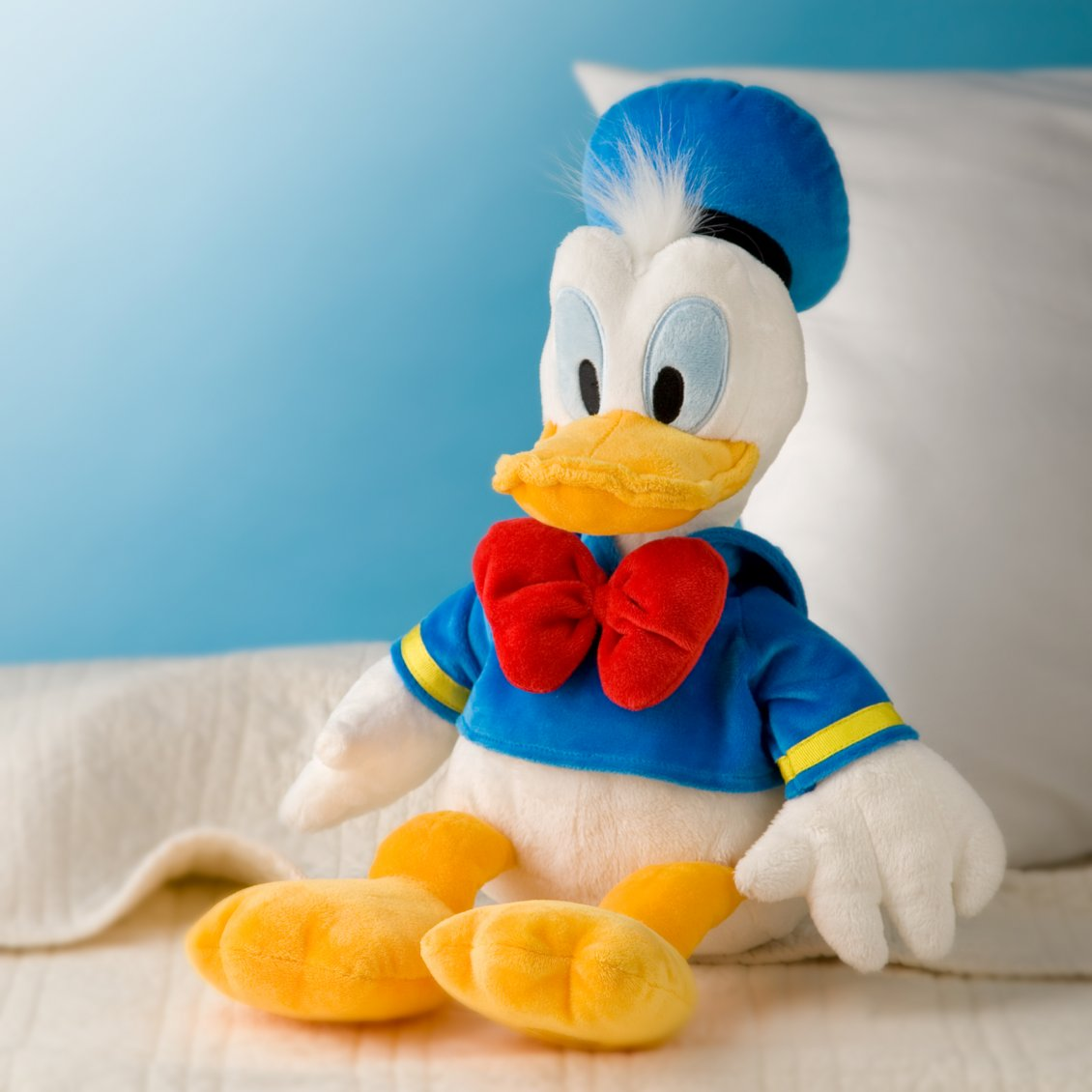 Donald Duck, Plush Toy On The Sofa