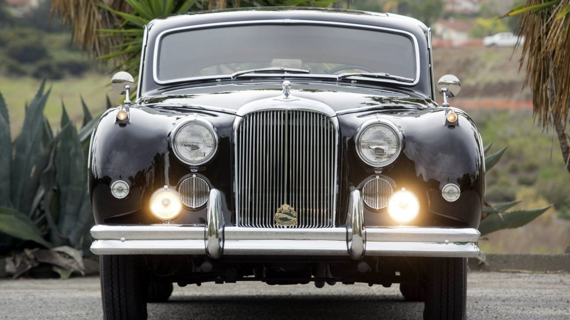 Download Wallpaper Black Classic Jaguar on road - Vintage car