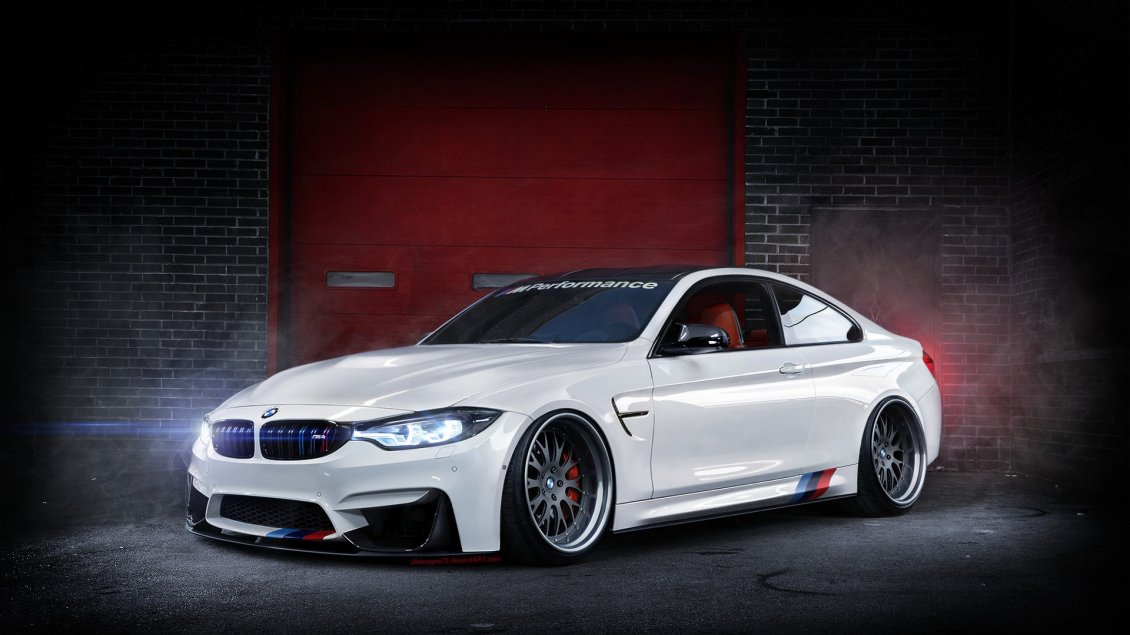 Download Wallpaper A beautiful white BMW F82 M4 in a garage