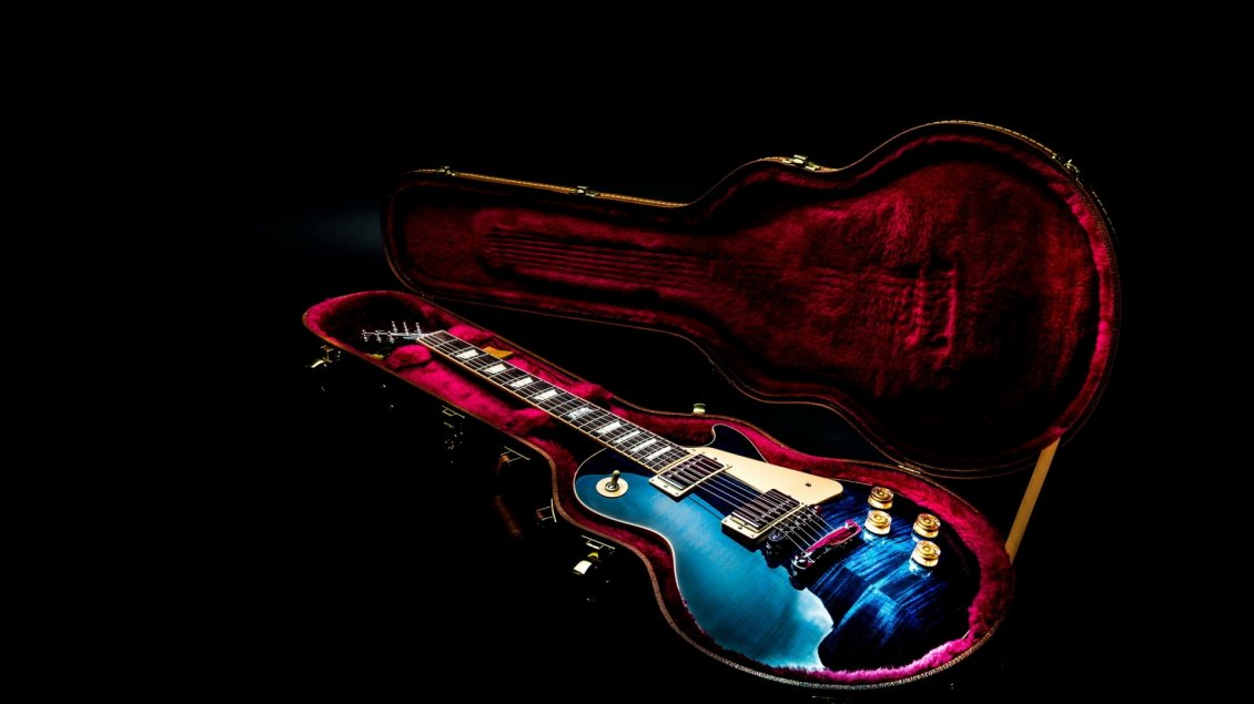 Colorful Guitar In A Red Cover