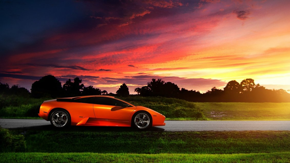 Orange Lamborghini Murcielago in the purple sunset