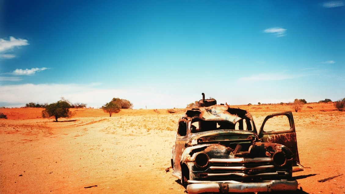 Download Wallpaper Old and very rusty classic car in the dessert