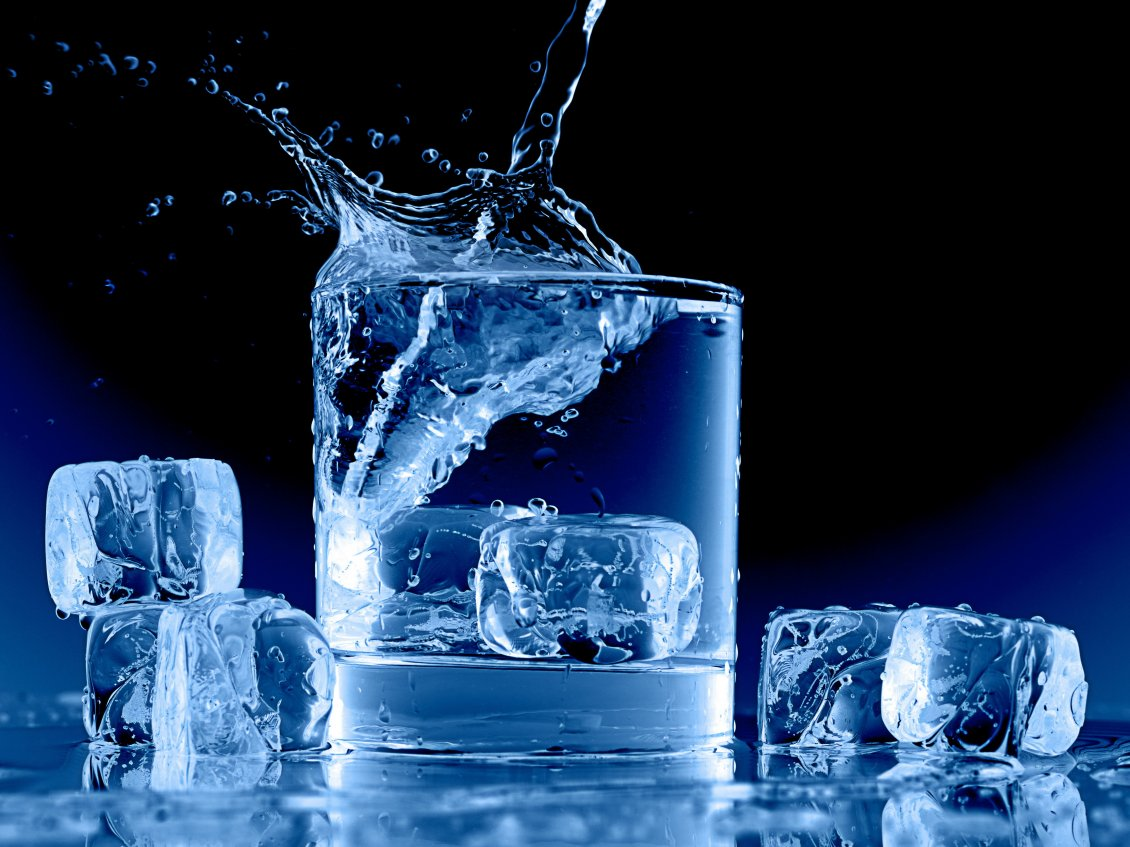 Water In A Glass Full With Ice Cubes