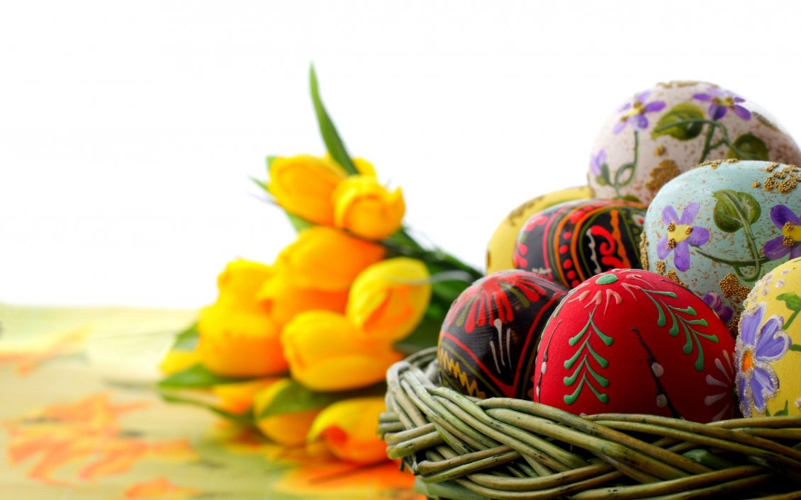 Download Wallpaper Colorful Easter eggs and yellow tulips on background