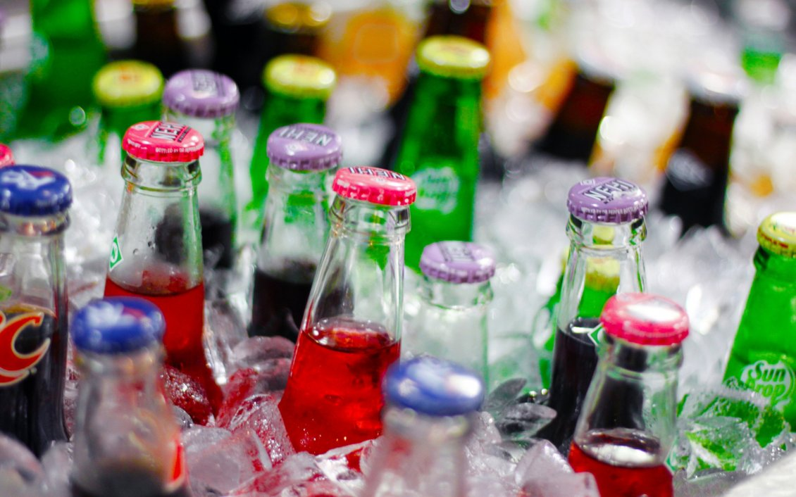 Download Wallpaper Bottles of soda in the ice - Fresh drink in a summer hot day