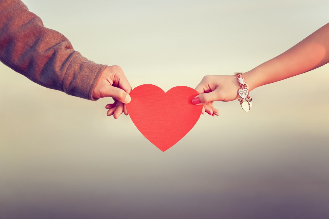Download Wallpaper Love between two people - Red Heart give on Valentines Day