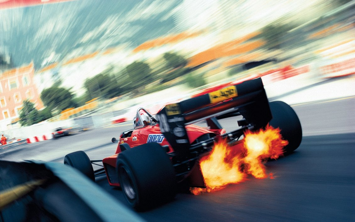 Download Wallpaper Super speed on the race - Fire from the wheels Formula 1
