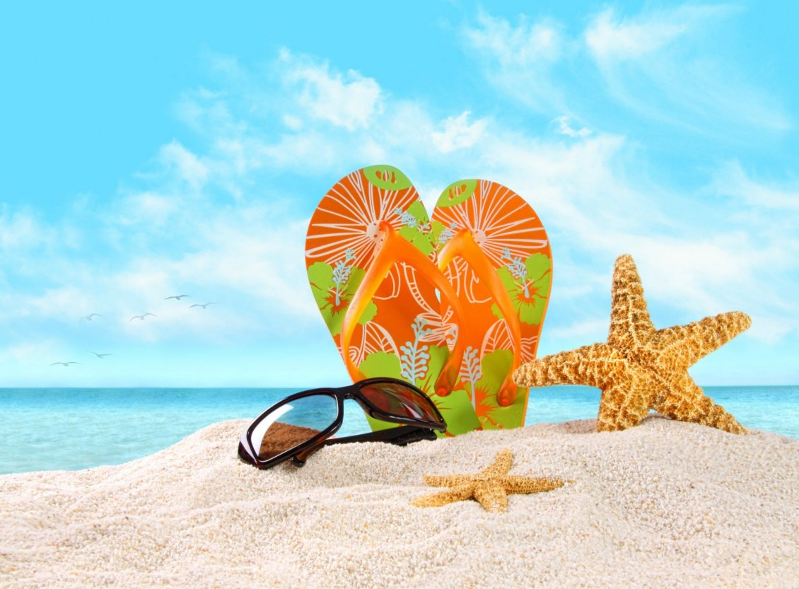 Download Wallpaper Flip flop and sunglasses on the beautiful golden beach sand