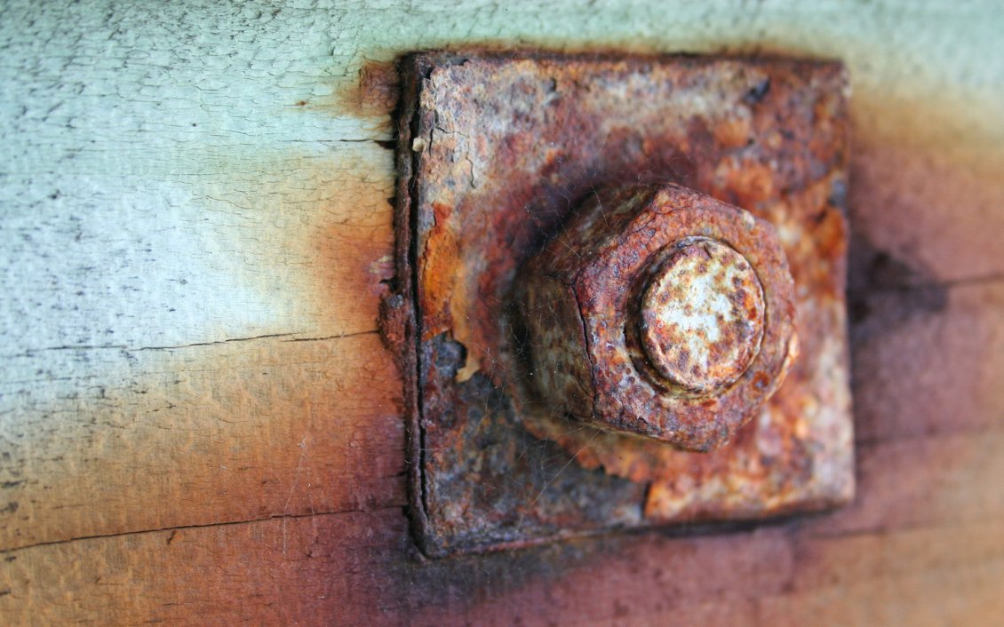 Download Wallpaper Old and rusty piece of iron - screw in wood HD wallpaper