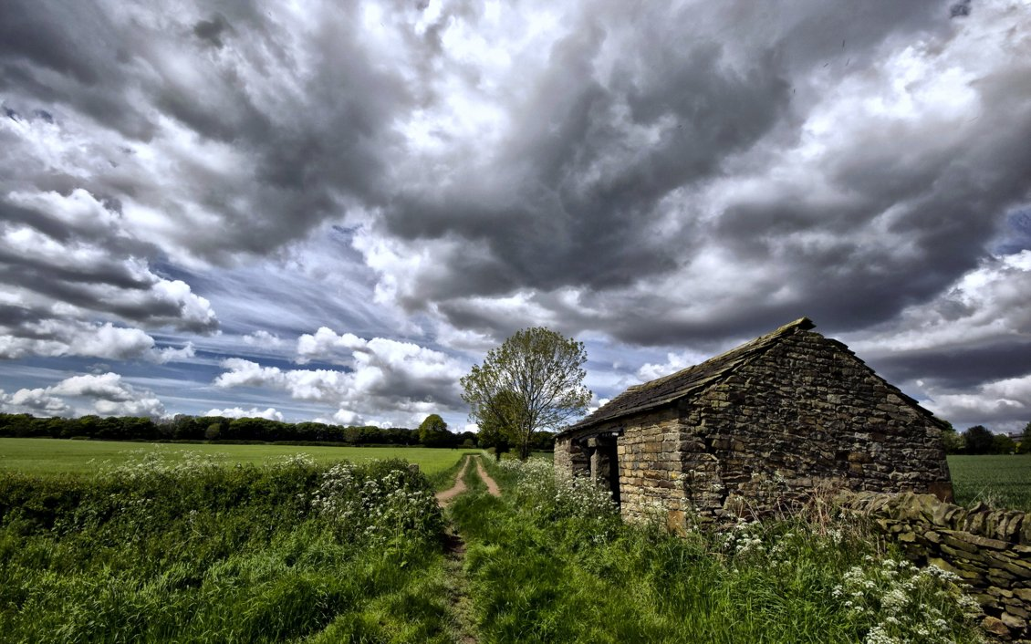 Download Wallpaper Old rock house cottage and country road near green field