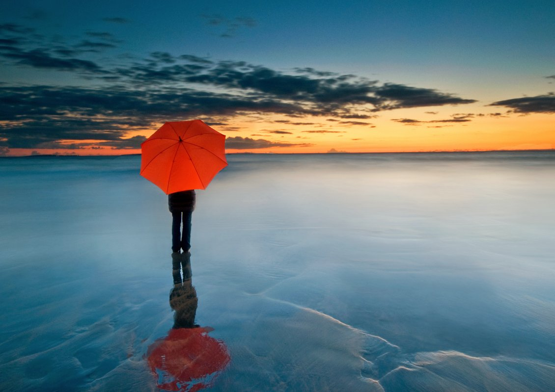 Download Wallpaper Abstract photo - Man with orange umbrella on a frozen water