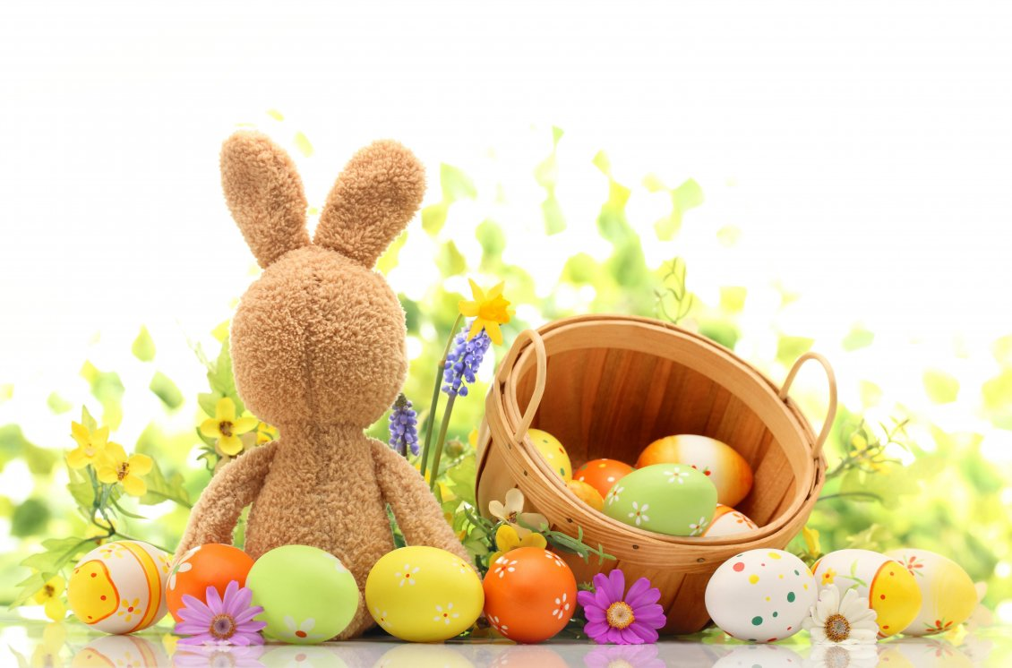 Download Wallpaper Fluffy Easter bunny with a basket full with painted eggs