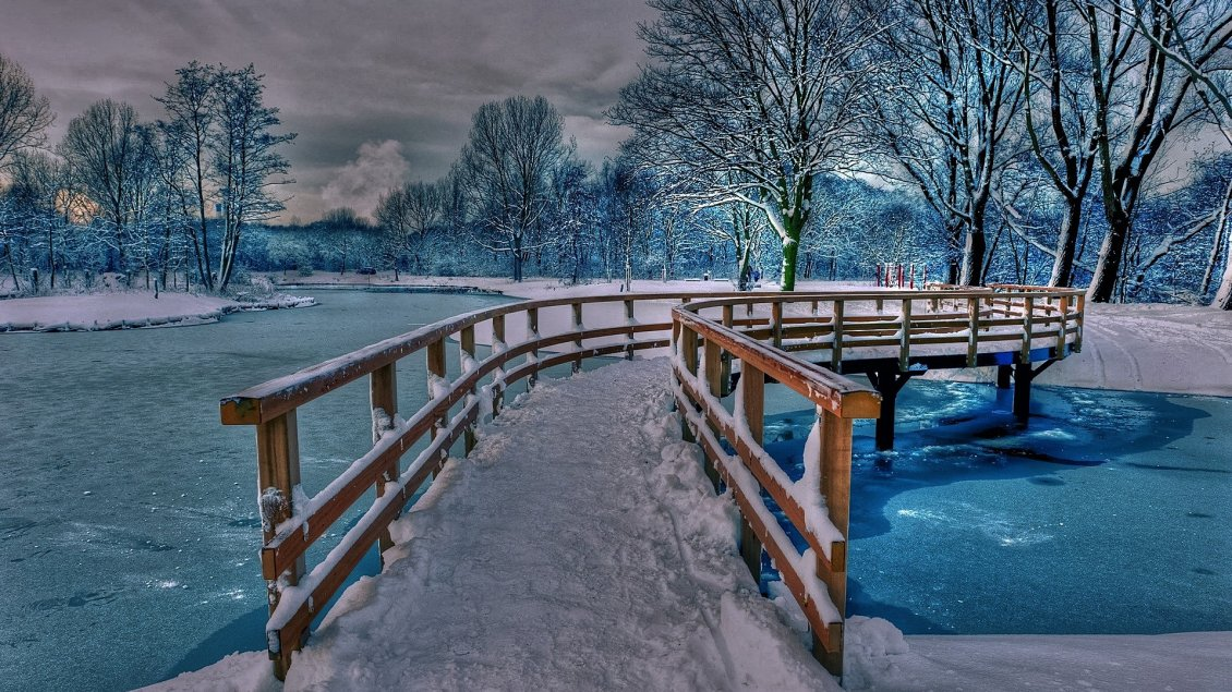 Download Wallpaper Wonderful frozen bridge over a frozen lake with blue water