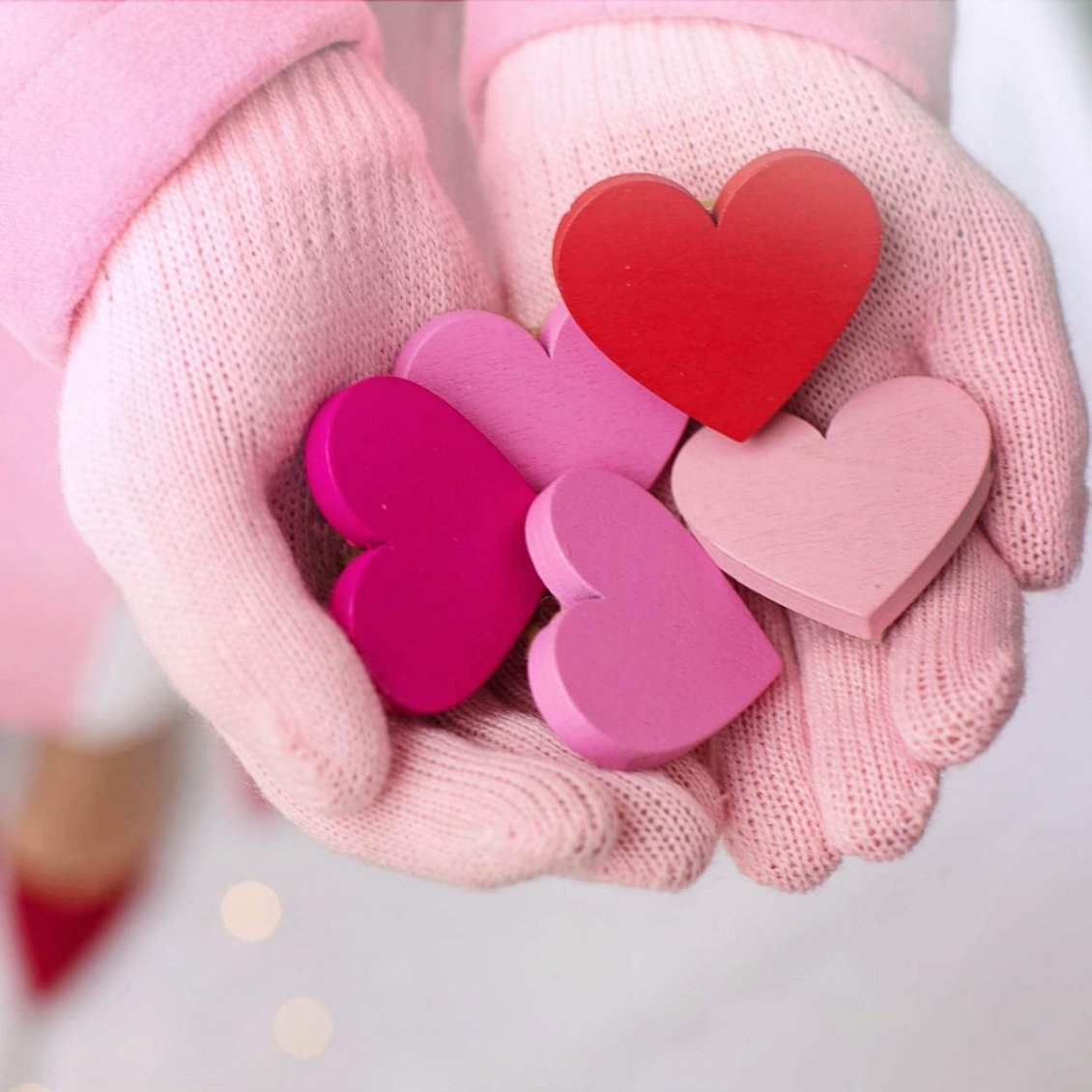 Download Wallpaper Painted wooden hearts on my hand - Love  red pink colors
