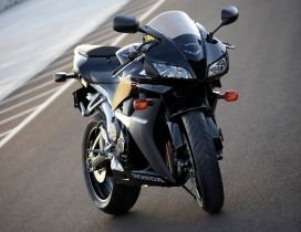 Black Honda CBR 600RR on the road