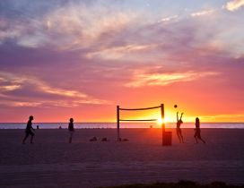 Volleyball on beach, sunset