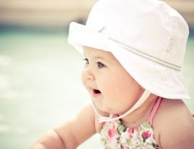 Cute baby girl with white hat