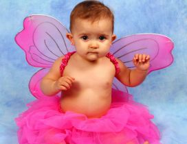 A sweet ballerina girl with pink butterfly wings
