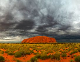 Ayers Rock and sky with clouds in Australia