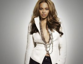 Beyonce with white jacket and necklace of beats