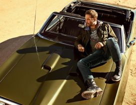 Paul Walker on the green car in the desert
