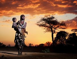 African woman holds her baby in arms