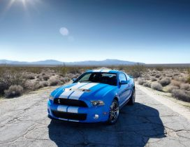 Blue Ford Mustang with white lines