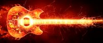 Guitar with fire and sparks