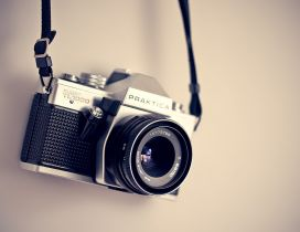 Classic photo-camera on the wall - abstract wallpaper