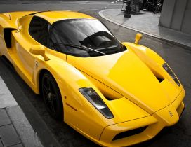Yellow Ferrari Enzo on the street