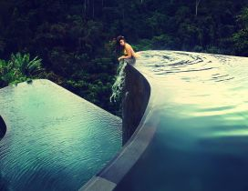 Girl in a pool with several levels