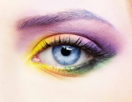 Girl with colorful makeup and blue eyes