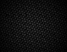 Woven black textile fibers