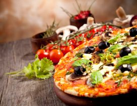 Pizza with olive and tomatoes sauces